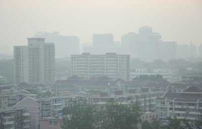 Beijing under smog alert orders factories to close or cut output